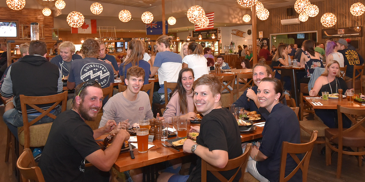 Group seated at a table in Cabin 401 Bar & Grill