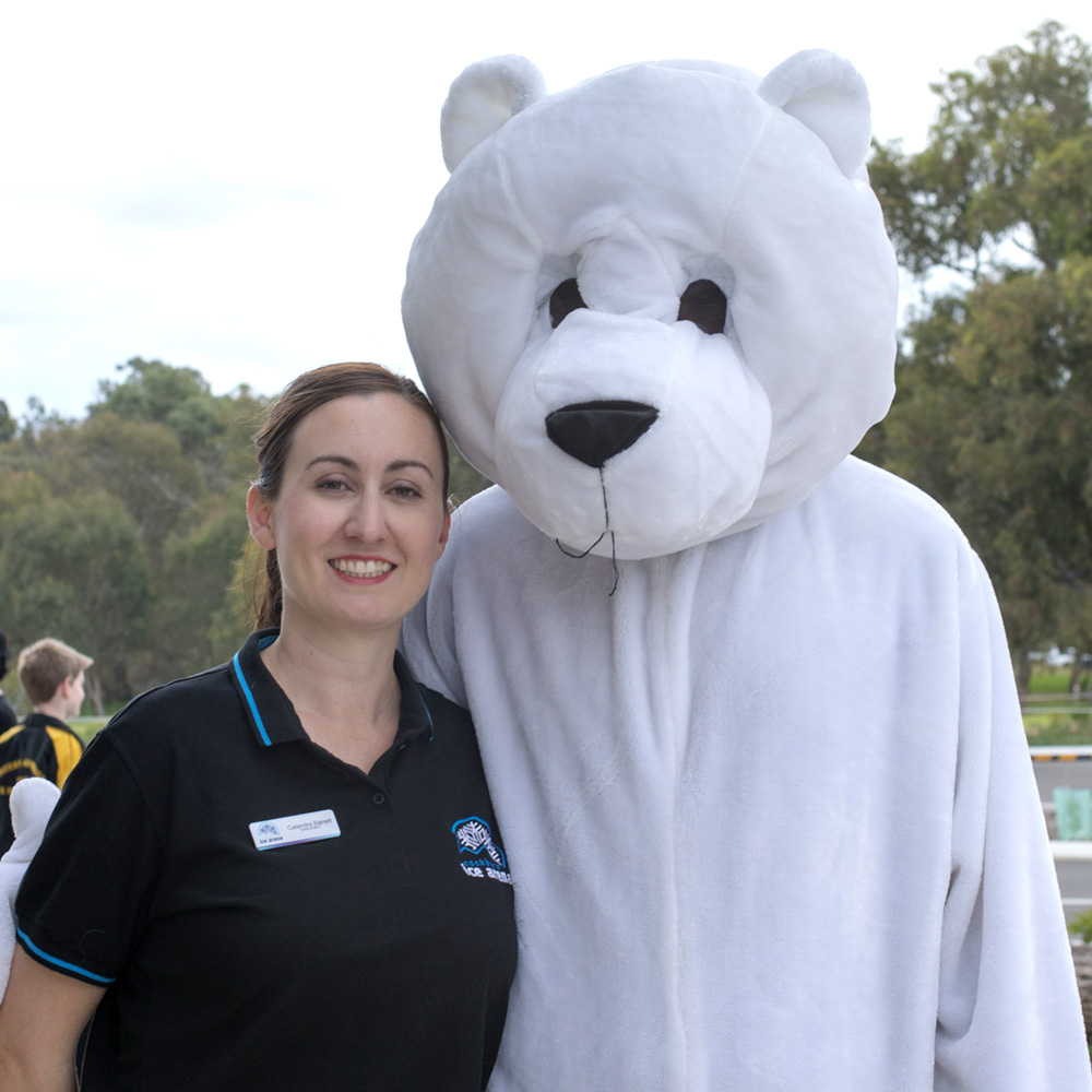 General Manager Calandra Barrett with Blades the Bear