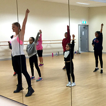 Children learning hip hop dance in the dance studio