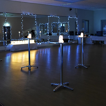 Dance studio set up for a private cocktail style engagement party