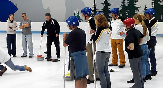 A group of beginners at a Learn to Curl Lesson