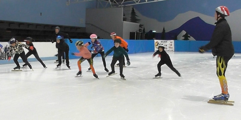 Young skaters starting a speed skating race.