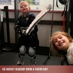 Young boy hockey player and his sister