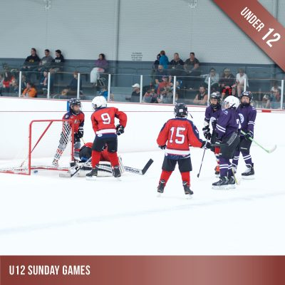 Product image for Sunday Games. Group of under 12 aged kids playing ice hockey