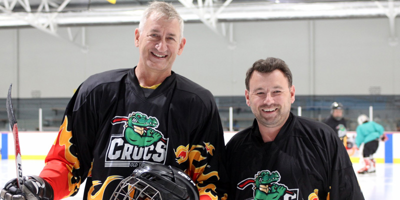 Two players from the Cockburn Crocs Old Timers Ice Hockey League